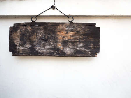 old sign: Old wooden sign hanging on wall