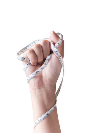 health care fight: Woman hand fist with measuring tape isolated in white
