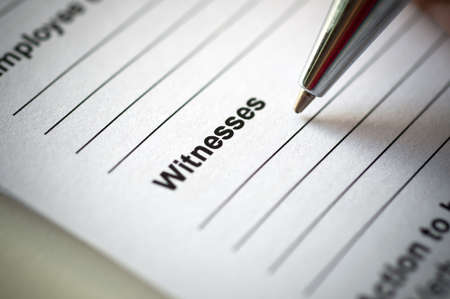 witnesses: Hand writing on incedent witnesses form. Stock Photo
