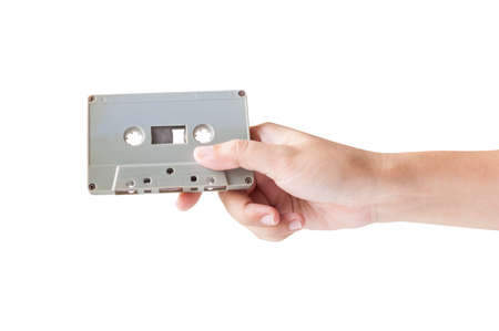 cassette tape: Hand holding cassette tape isolated on white background.
