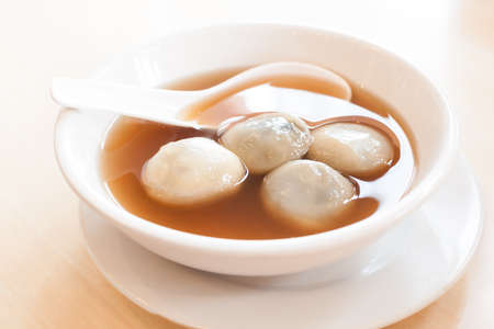 Rice and sesame dumpling in ginger syrup, Chinese traditional dessert.