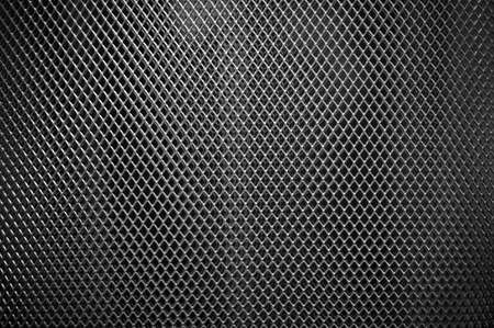 Perforated metal grate background. Stock Photo
