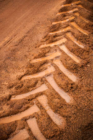 dirtroad: Tractor trail on the muddy ground Stock Photo