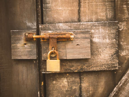 doorlock: Old wooden door with metallic doorlock Stock Photo