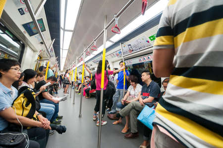 hand rails: Hong Kong, China - October 04, 2015 : Passengers on the Hong Kong MTR. It is the most popular transport in Hong Kong.