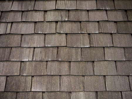shingles: Old wet wooden shingles roof. Stock Photo