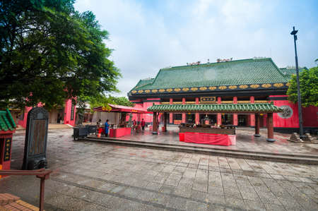 worshipping: Hong Kong, China - October 04,2015 :People at Che Kung Temple. The Temple is a landmark temple and a popular tourist attraction in Hong Kong.