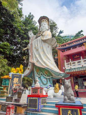 repulse: Hong Kong, China - October 03, 2015 : Big  Quan Yin statue at Kwum Yam Taoist shrine at the southeastern end of Repulse Bay