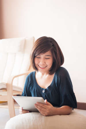 blank tablet: Young asian woman holding blank digital tablet.