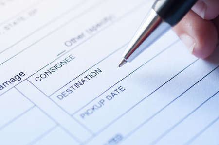 consignee: Hand writing detail on business paper form. Stock Photo