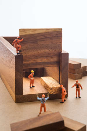 miniature: Worker moving goods package out from store.