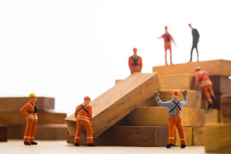 Worker making wood step stair. Success building concept. Stock Photo