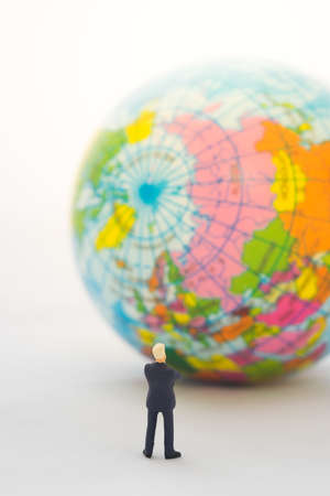 global thinking: Businessman hand thinking or making decision in front of the global, Global business concept. Stock Photo