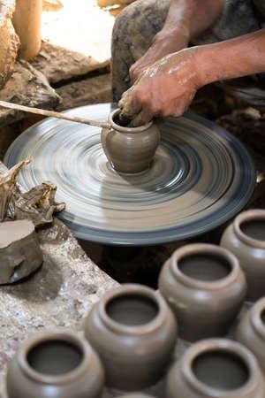 craftswoman: Artisan hands making clay pot