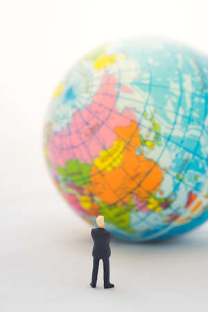global thinking: Businessman hand thinking or making decision in front of China map on global map , Global business concept. Stock Photo