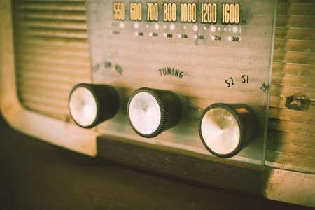 transitor: Old transistor radio analog dial button, retro image processed. Foto de archivo