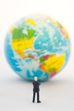 global thinking: Businessman hand thinking or making decision in front of America map on the global, Global business concept.
