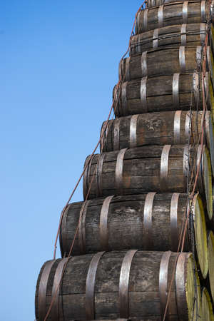 wood staves: Old wooden barrel stack with blue sky background. Stock Photo