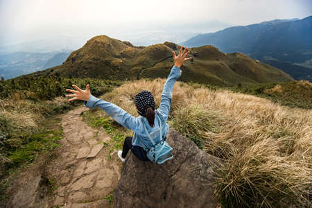 Traveller enjoy after reaching the peak of highest mountain in Taipei, Taiwan. Qixing Mountain at Yangmingshan National Park