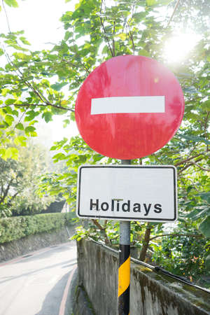trafic stop: No entry in Holidays traffic sign.