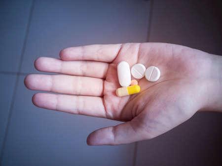 Pills in hand. Stock Photo