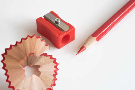 Red colored pencil with sharpener.