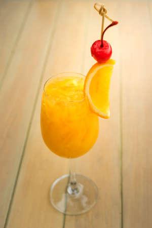mocktail: Fresh iced orange juice mocktail. Focused on orange piece.