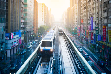 best way: Taipei, Taiwan - February 02, 2016 : View of Taipei city with metro train approaching Station. The Taipei MRT is one of the best way to travel around the city.