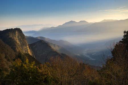 ali: Beautiful morning sunrise with scene of Yushan mounatin under bright blue sky from Alishan National Park, Taiwan Stock Photo