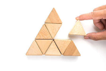 Triangles wood block arranging as stack step can use for business template or bullet or infographic. Wood block on white background. Archivio Fotografico