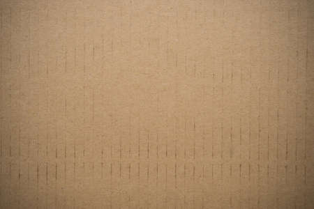 paperboard: Brown cardboard or paperboard texture background