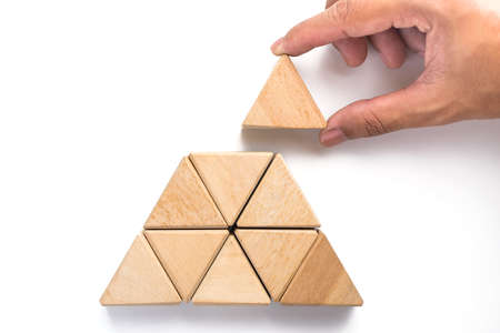 Triangles wood block arranging as stack step can use for business template or bullet or infographic. Wood block on white background. Standard-Bild