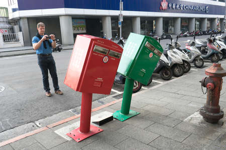gained: Taipei, Taiwan - March 03, 2016 : Leaning postboxes at Zhongshan district, Taipei. The boxes, two of 10,986 around Taiwan, gained fame after Typhoon Soudelor ripped across the island on August 8, 2015
