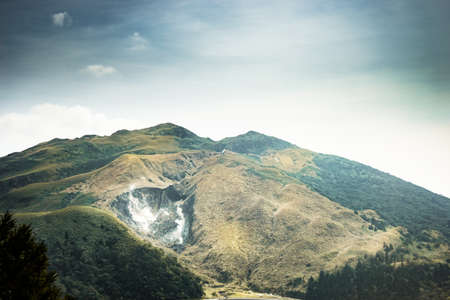 Xiaoyoukeng active crater in Datun post volcano area located in Yangmingshan National Park, Taipei, Taiwan. Retro image processed.