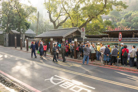 Beitou, Taiwan - March 05, 2016 : People queueing in front of public bath house at early morning. Many of the the baths are old style Japanese houses.