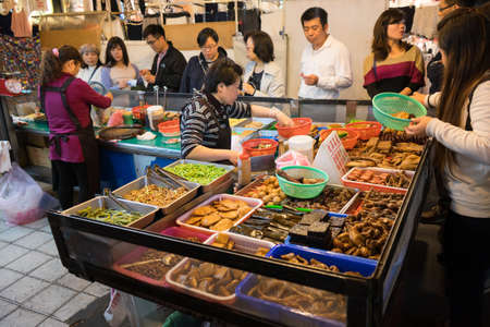 chinese ethnicity: TAIPEI, TAIWAN - March 05, 2016: Street food shop with crowd of custumers in Taipei, Taiwan.