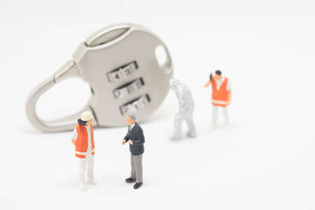lock concept: Business security concept. Businessman calling technician specialist to solving key lock problem.