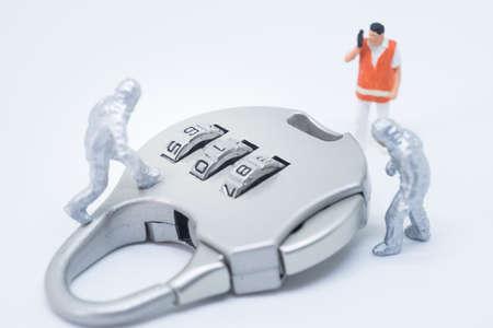 crime solving: Business security concept. Technician specialist team solving key lock problem.