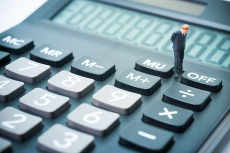 account executive: Business startup calculating concept. Businessman thinking or making decision with calculator.