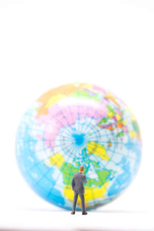 global thinking: Global business concept. Businessman  thinking or making decision in front of the globe.