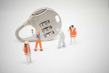 crime solving: Business security concept. Technician team pecialist solving key lock problem.