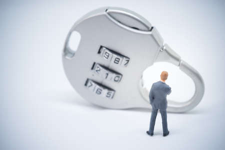 lock concept: Business security concept. Businessman stading in front of key lock with password.