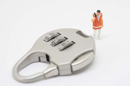 lock concept: Business security concept. Technician specialist with key lock problem.