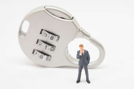 crime solving: Business security concept. Businessman stading in front of key lock with password.