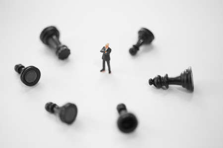 choose person: Concept of business strategy. Businessman with a lose chess pawn.