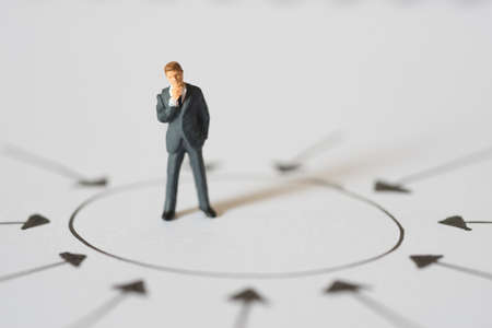 centric: Business concept of Center management. Businessman standing and thinking at center of arrow point