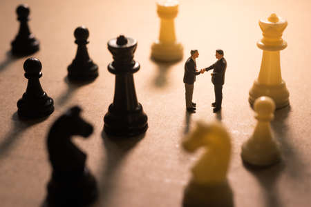 business game: Concept of business strategy. Businessman with a chess game.