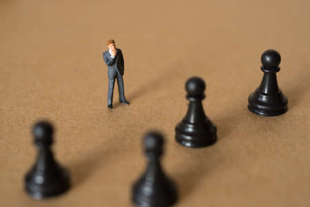 choose person: Concept of business strategy. Businessman with a chess knight.