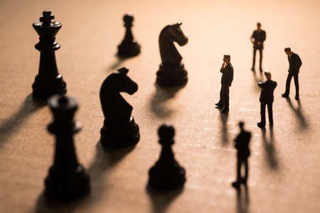 group strategy: Concept of business strategy. Businessmen team group with chess war. Stock Photo