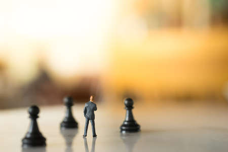 business concern: Concept of business strategy. Businessman with a chess pawn. Stock Photo